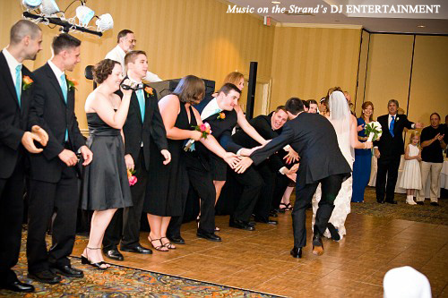 The bride and groom's exchange with their wedding party caps the entertaining grand entrance with finesse.