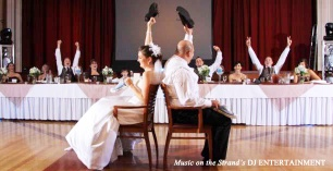 The bride and groom play the newlywed (shoe) game