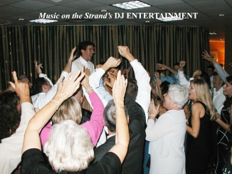 The DJ at the Myrtle Beach Hilton has the wedding guests gather around the bride and groom for a joyous exchange.